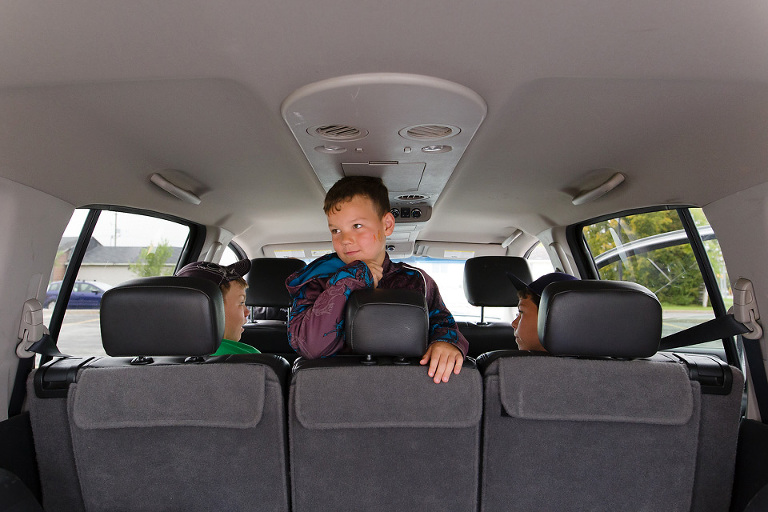 thoughtful boy in backseat - Documentary Family Photography