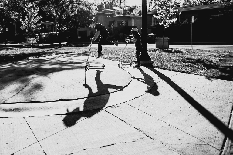 kids and shadows play on scooters - Documentary Family Photography
