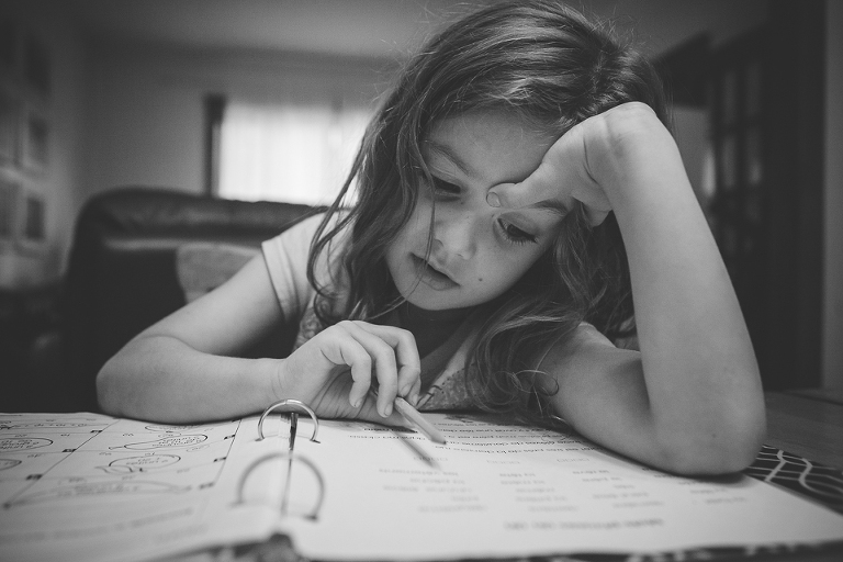 girl does homework - Documentary Family Photography