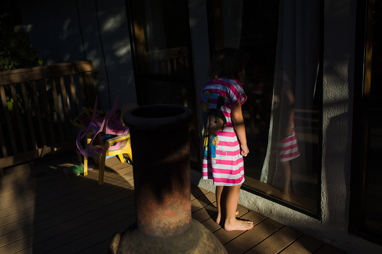girl and reflection in dappled light - Documentary Family Photography