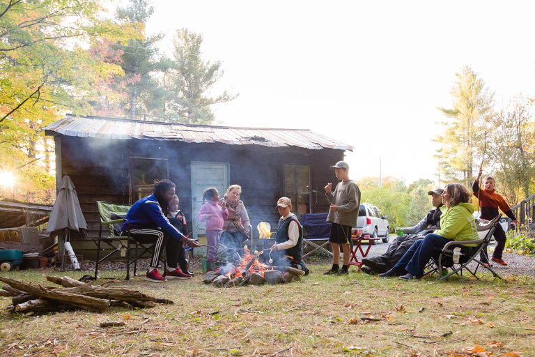 large family around campfire - Documentary Family Photography