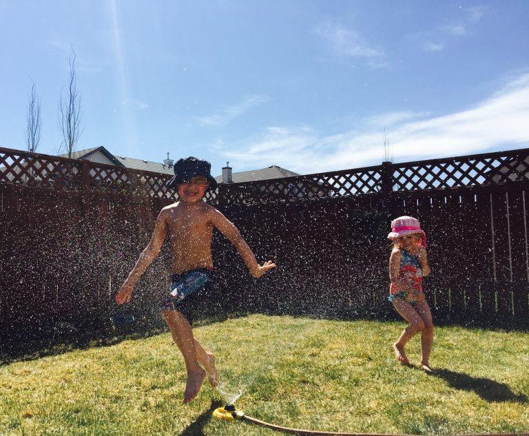 kids play in sprinkler - documentary family photography