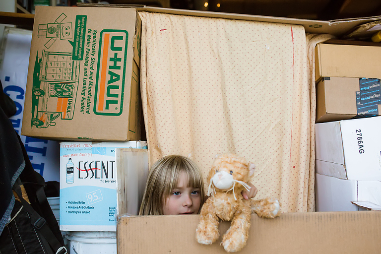 girl in box fort with stuffed animal - Documentary Family Photography