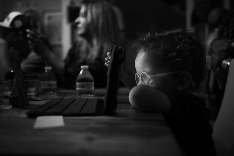 boy sits at table -Documentary Family Photography