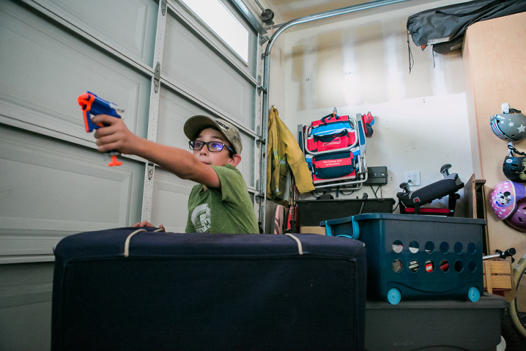 kids play with nerf guns in garage - Documentary Family Photography