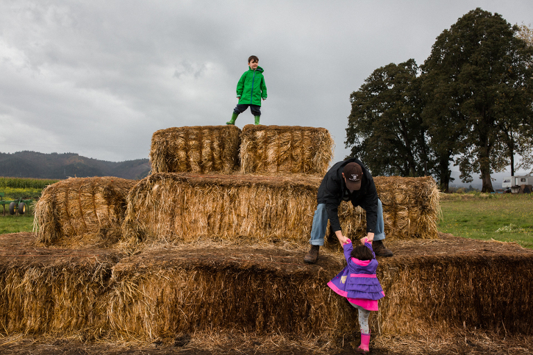 kids climb hay bale tower - Documentary Family Photography