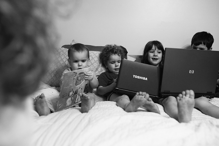 kids on bed with laptops - Documentary Family Photography