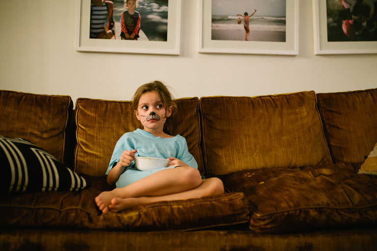 girl on couch with facepaint - Documentary Family Photography