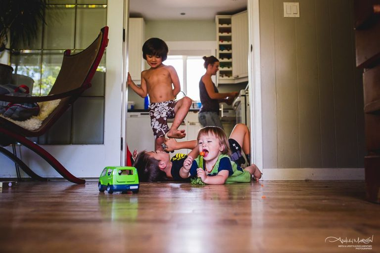 kids rolling around on floor - Documentary Family Photography