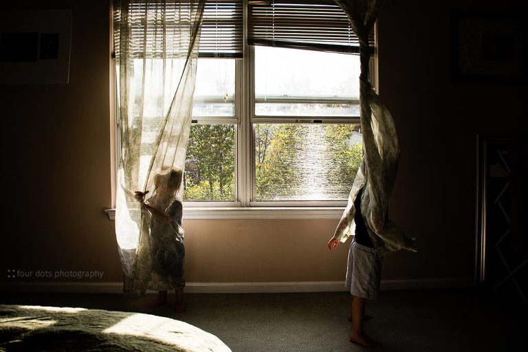kids play in lace curtains - Documentary Family Photography