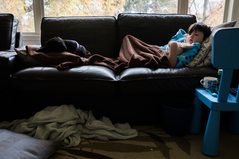 sick kids on couch - Documentary Family Photography