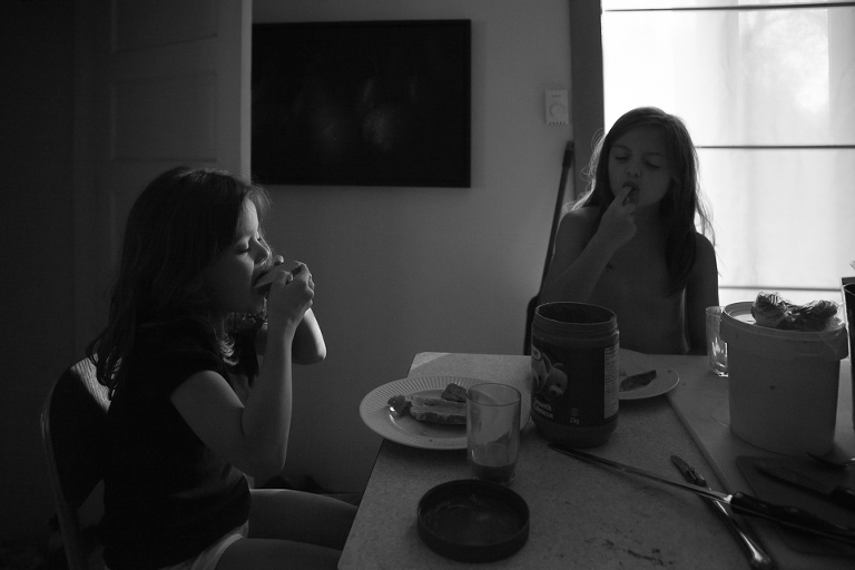 girls at dinner table - Documentary Family Photography