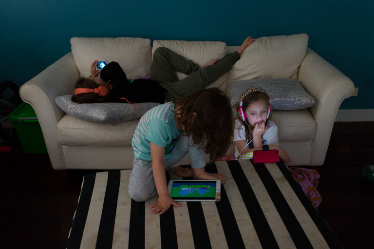 kids with electronics in living room - Documentary Family Photography