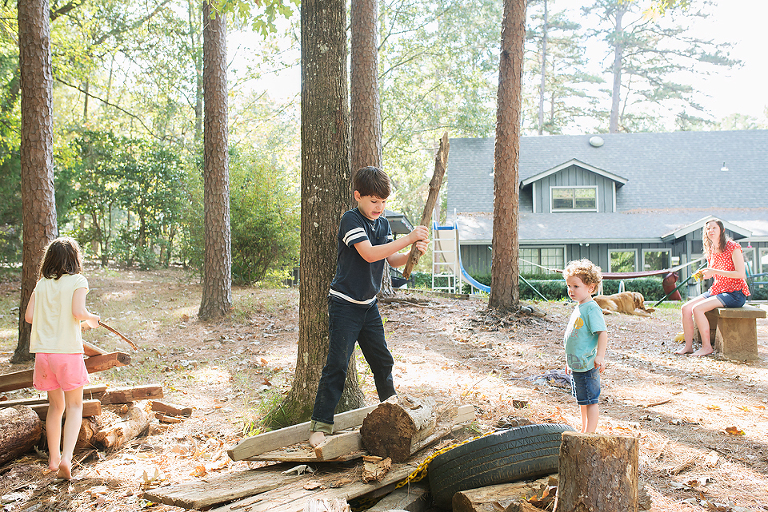 kids playing with logs - Documentary Family Photography