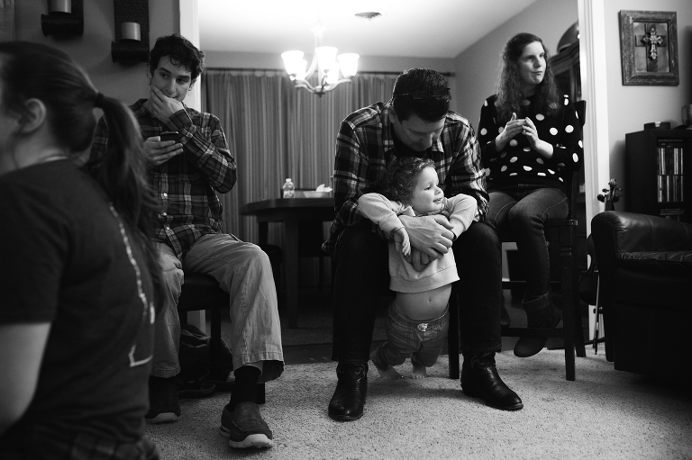father holds young boy - documentary family photography