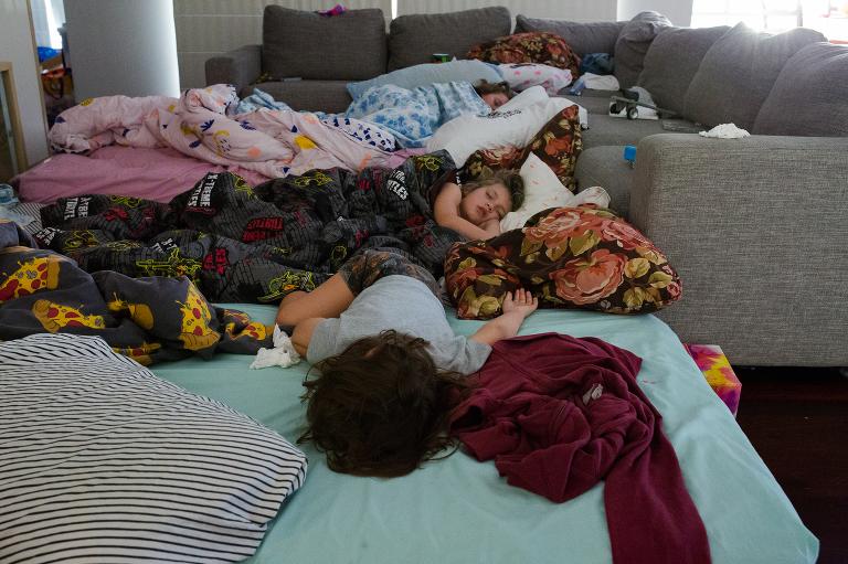 kids sleep in living room - documentary family photography