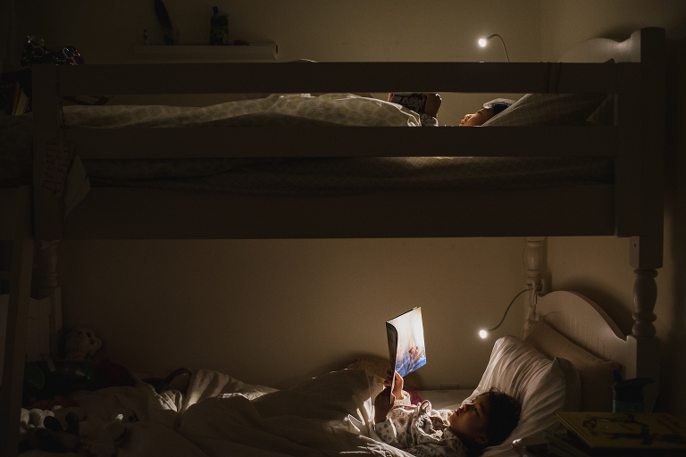 girls read in bunk beds - documentary family photography