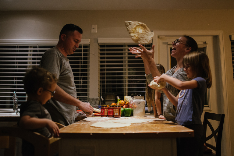 family makes pizza together -documentary family photography