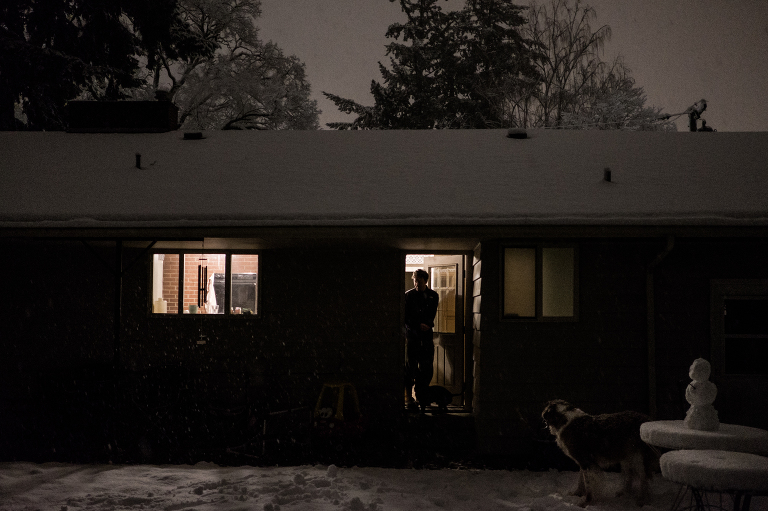 Man lets dog out at night -documentary family photography