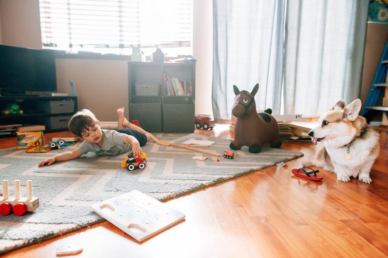 boy plays in empty living room