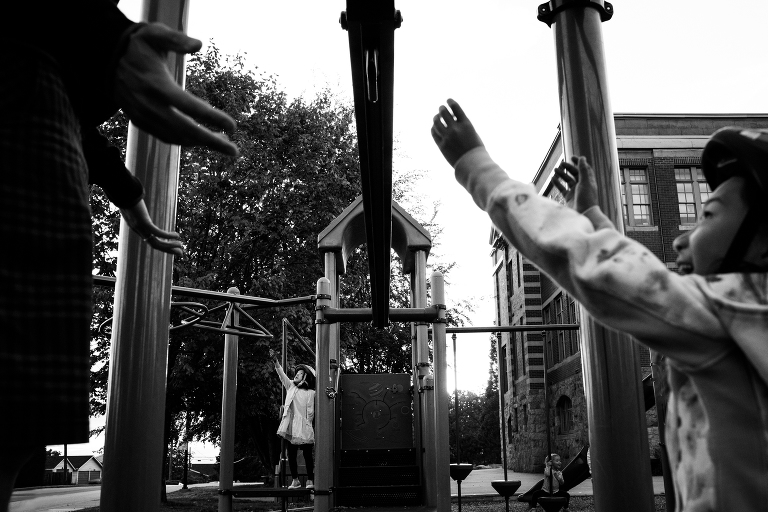 little kids reaching out for help at the playground