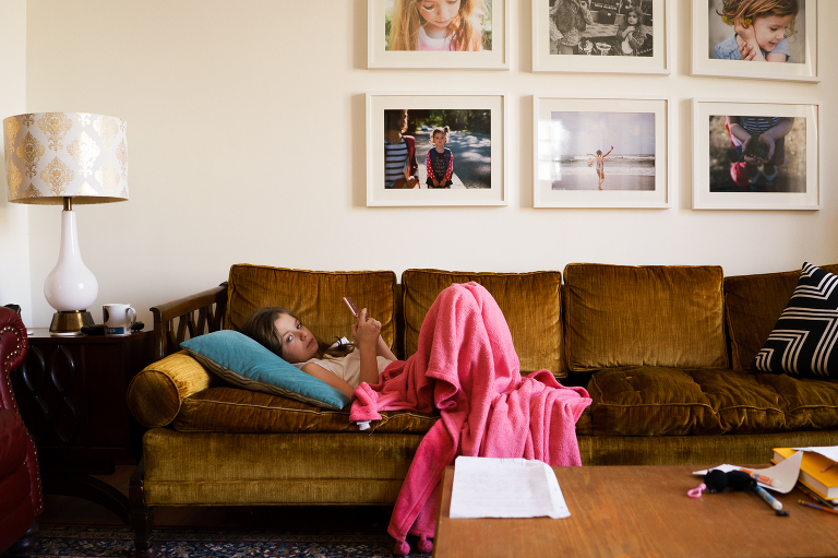 girl with phone on couch - Documentary Family Photography