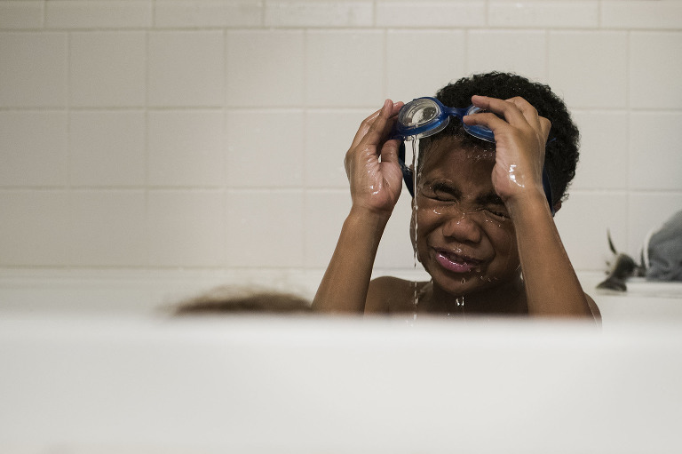 boy with goggles in tub - Documentary Family Photography