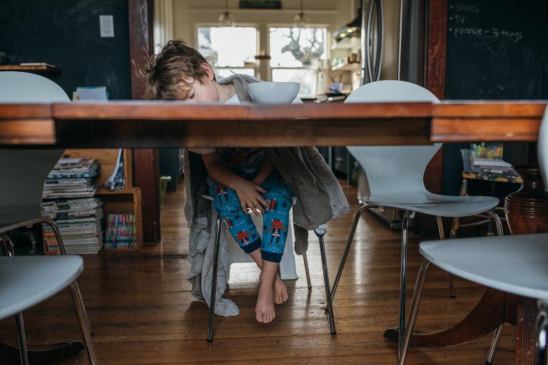 boy asleep a breakfast table - Documentary Family Photography