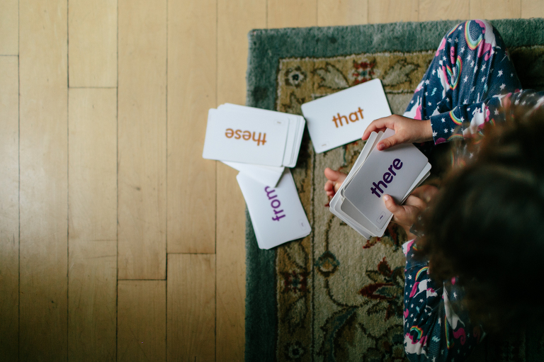 child with flash cards - Documentary Family Photography