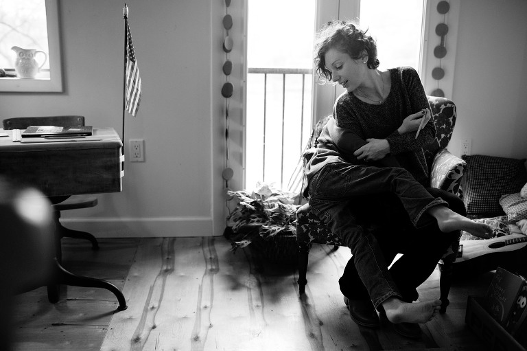mother tickles child - documentary family photography