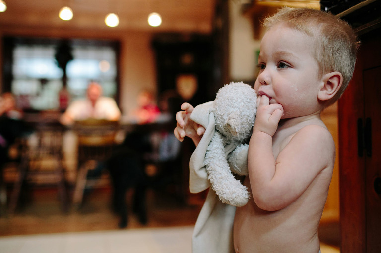 child with stuffed animal - documentary family photography