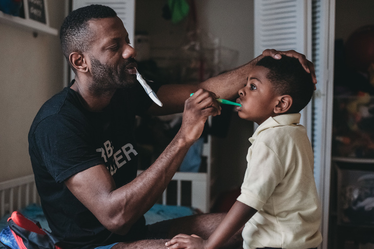 father brushes son's teeth - Documentary Family Photography
