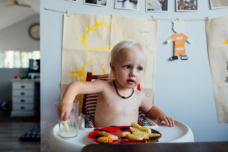 child dips french fried in milk - Documentary Family Photography