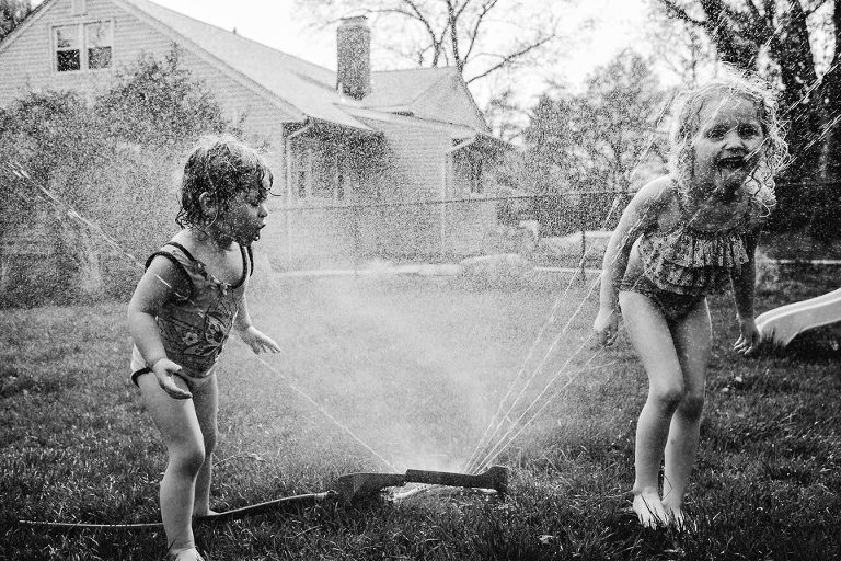 kids in sprinkler -documentary family photography