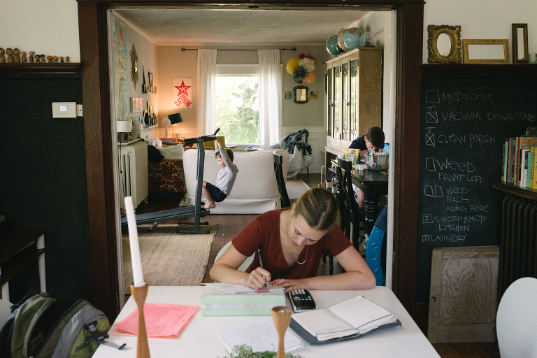 girl does homework in home - Documentary Family Photography