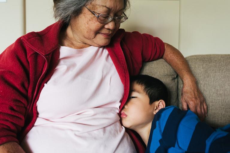boy asleep with grandma - Documentary Family Photography