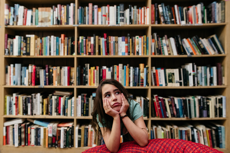 girl in library - Documentary Family Photography