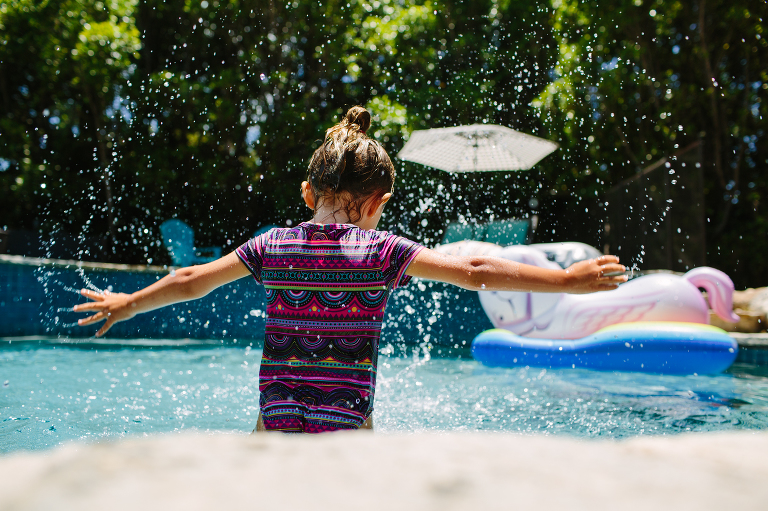 girl jumps in water - Documentary Family Photography