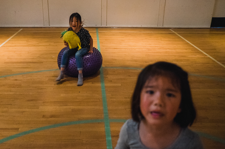 girls on exercise ball - documentary family photography