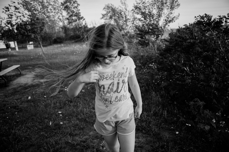 girl with wind blowing in hair - Documentary family photography