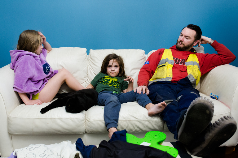 man with kids on couch- Documentary family photography