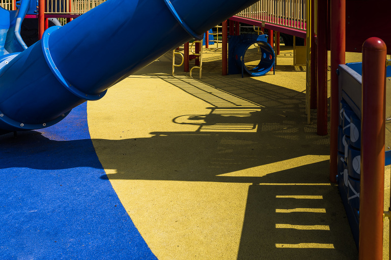 shadow of child on playground - Documentary family photography