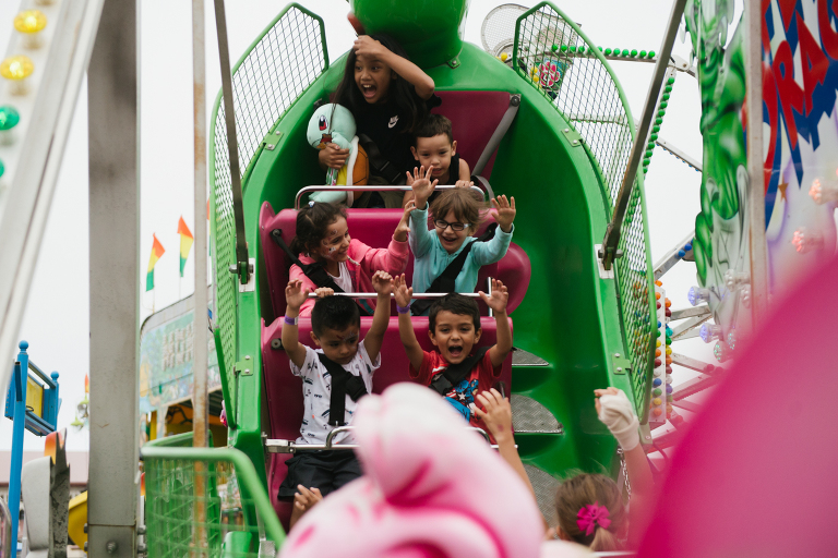 kids on amusement park ride - Documentary family photography