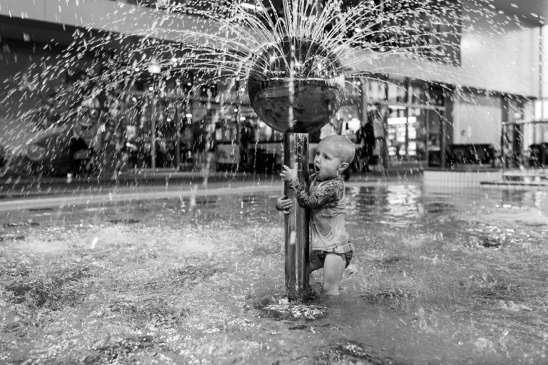 child at fountain - Documentary Family Photography