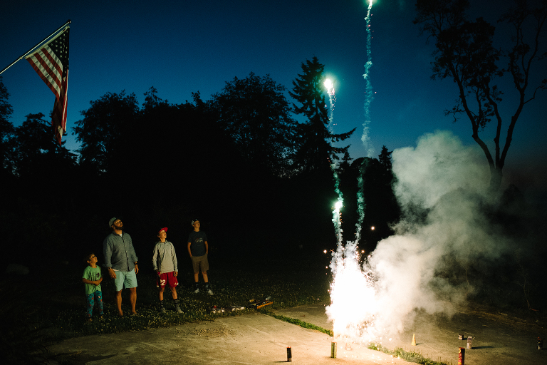 family shoots off fireworks - Documentary Family Photography
