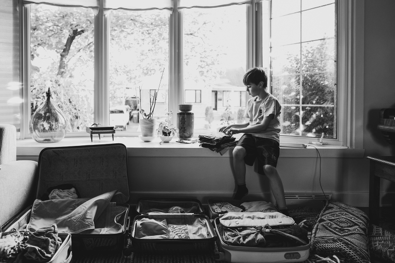 boy in window - Documentary Family Photography