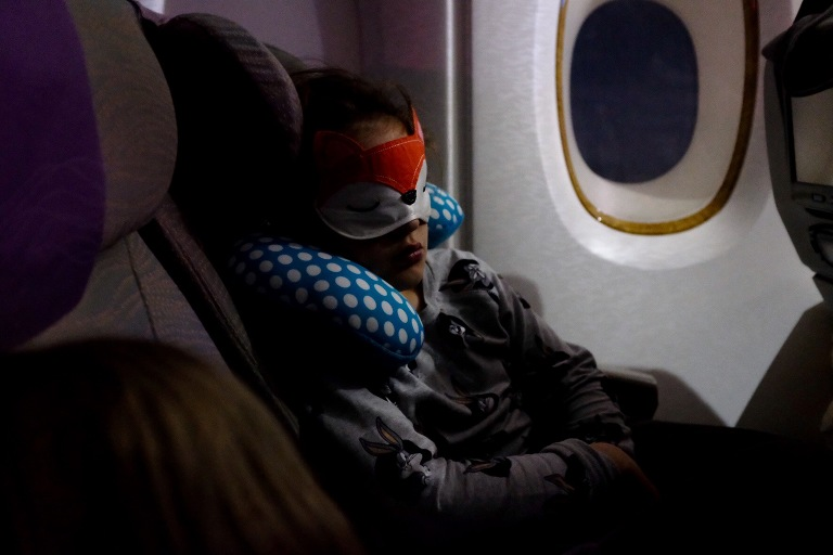 child asleep on plane - Documentary Family Photography
