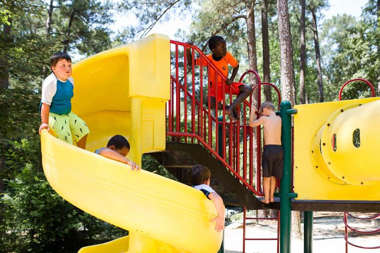 kids on twisty slide -Documentary Family Photography