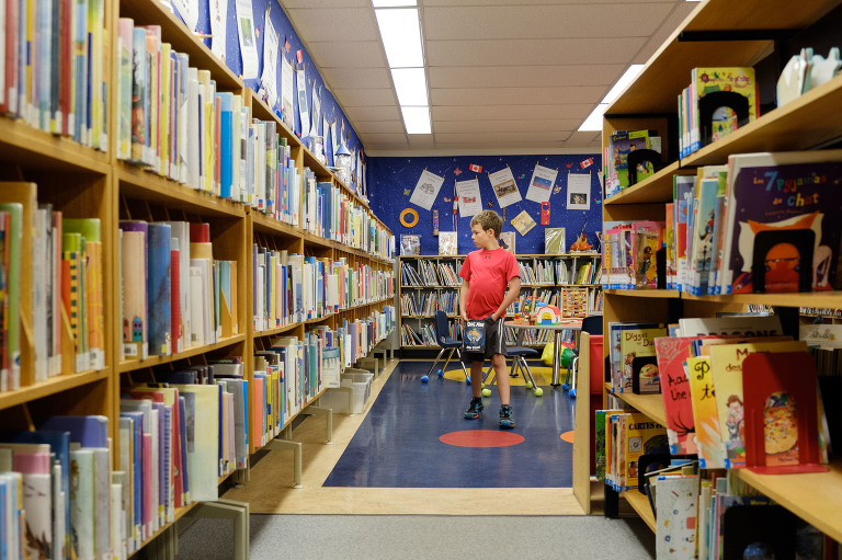 boy at library - Documentary Family Photography