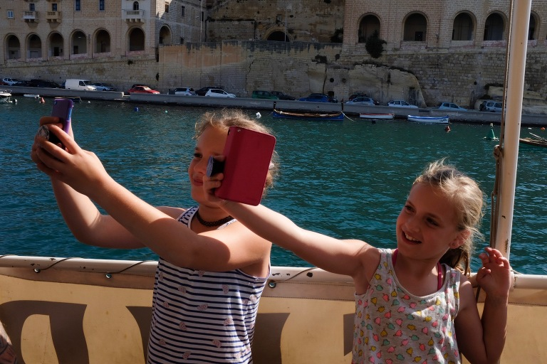 girls take selfies on vacation -Documentary Family Photography